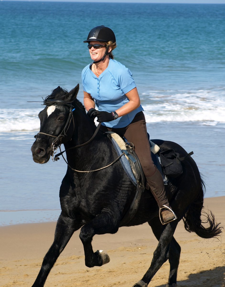 Glenys riding on a Beach in Spain