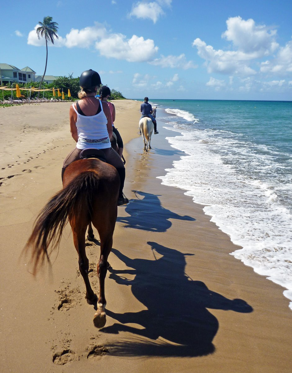 Glenys riding along the beach, Nevis