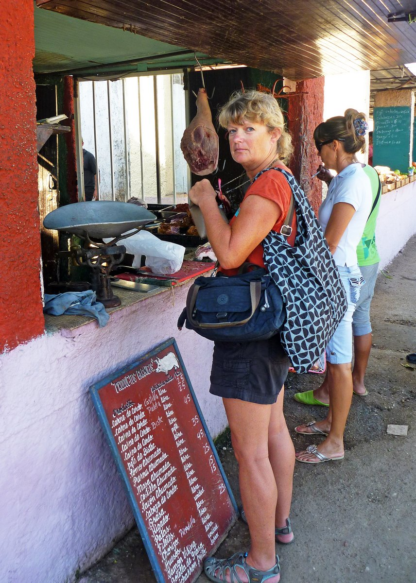 Buying meat in the market, Santa Marta, Cuba