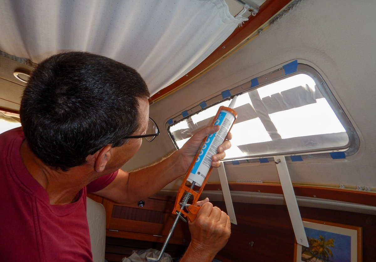 Applying sealant to the aft window
